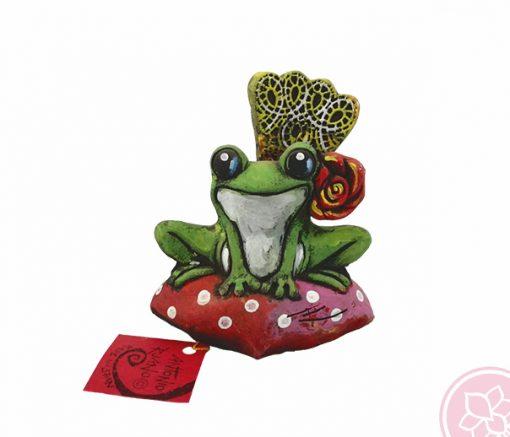 Figura de una rana flamenca con peina y flor. Esta pieza de cerámica es obra original del artista gaditano Antonio Ruano.